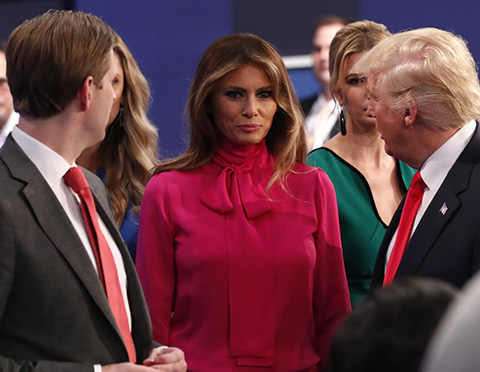 melania grabs pussy-bow blouse